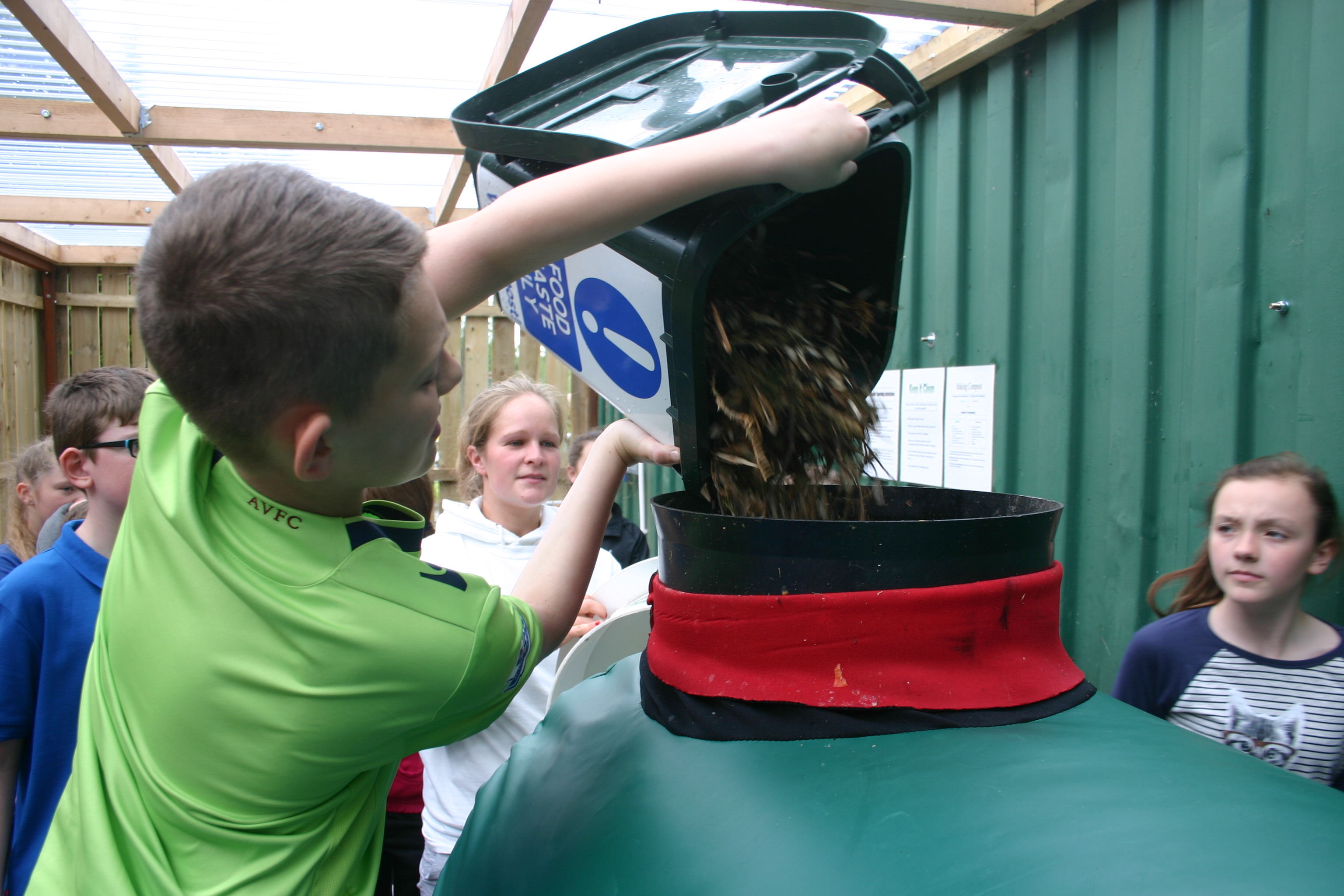 loading the food waste composter